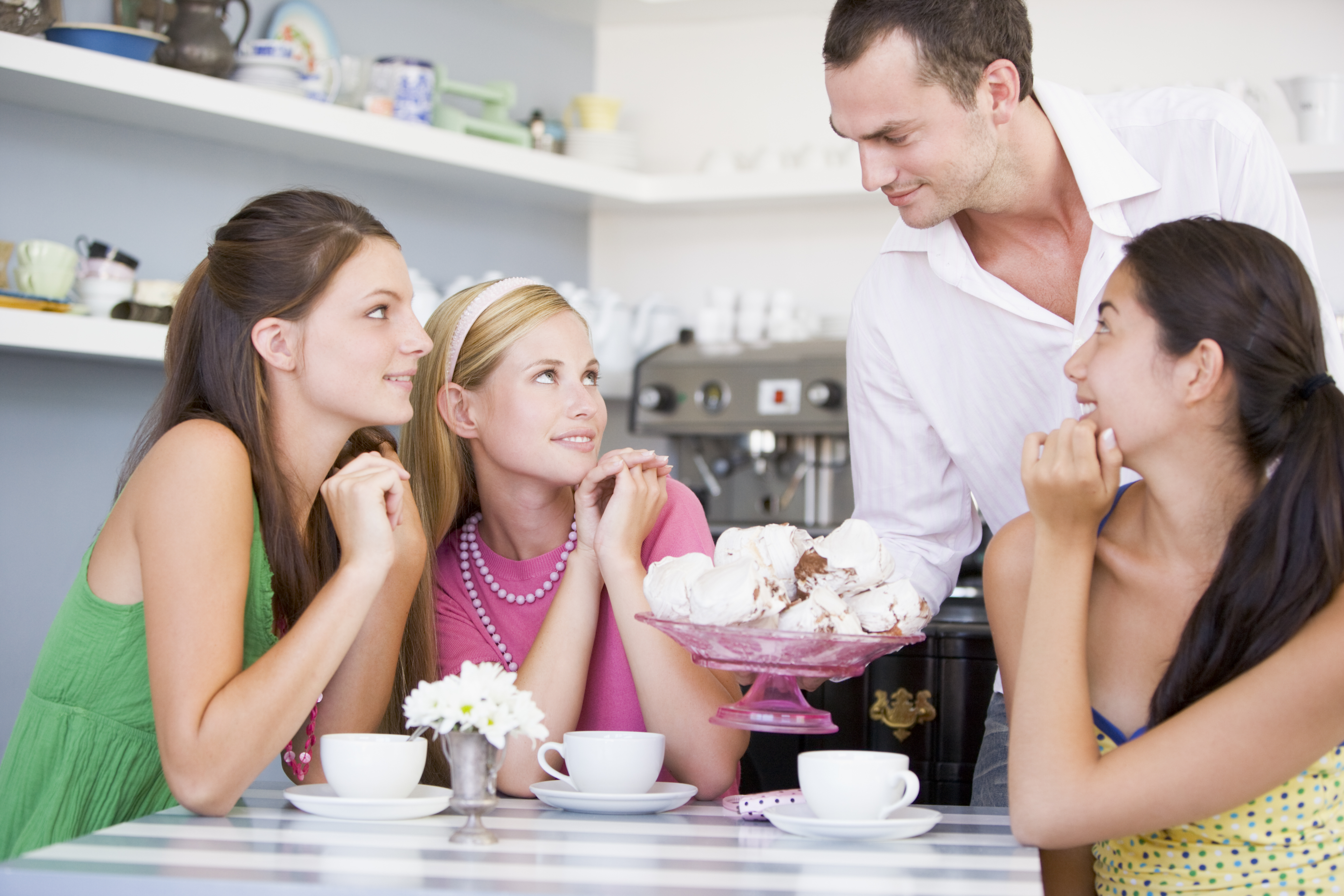 a-cafe-waiter-offers-young-women-teacakes_BKvH0Q0Bo.jpg
