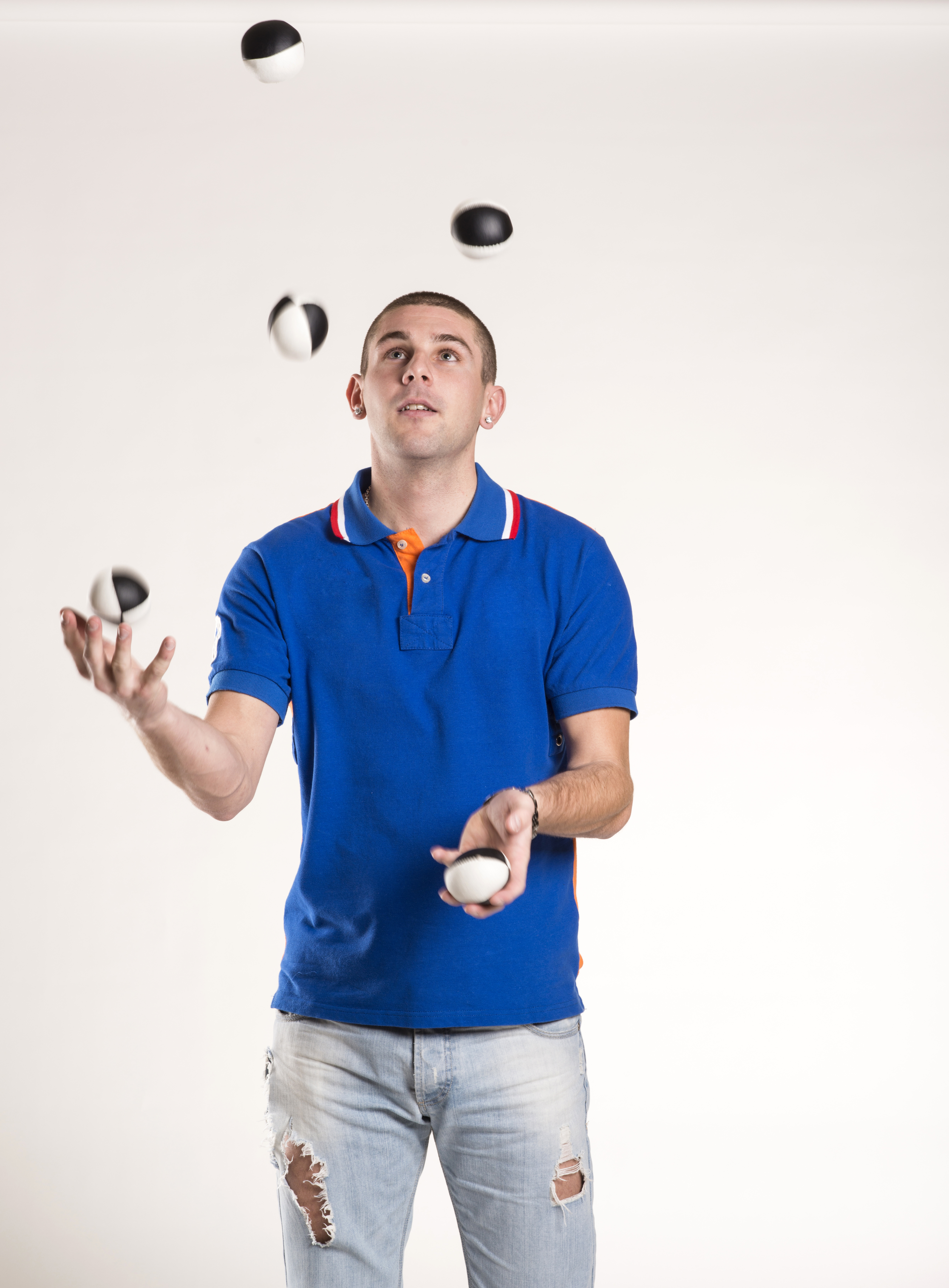 graphicstock-young-man-juggling-with-several-balls-at-once_HRcZ2H95bW.jpg
