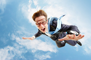 graphicstock-conceptual-image-of-young-businessman-flying-with-parachute-on-back_r6z_Ypge4-_thumb.jpg
